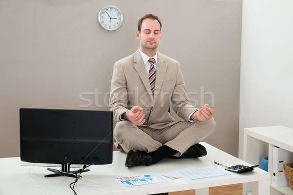 Businessman Meditating With Eyes Closed Stock photo © AndreyPopov