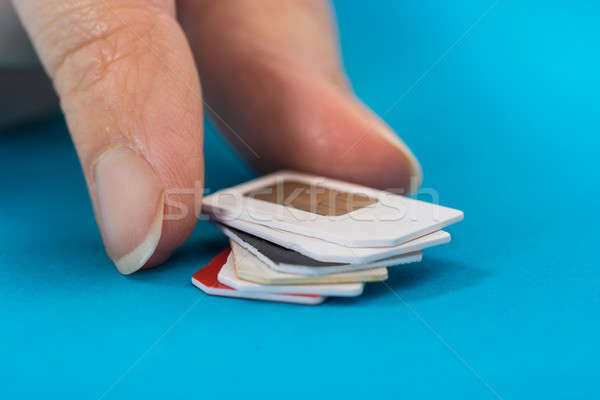 Person Hand Placing Stack Of Sim Card Stock photo © AndreyPopov