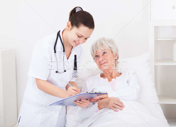 Doctor Giving Prescriptions To Patient Stock photo © AndreyPopov