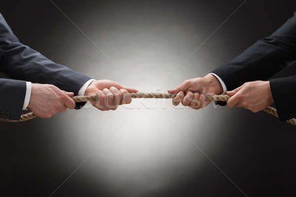 Two Businessman Pulling Rope Stock photo © AndreyPopov