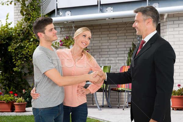 агент по продаже недвижимости рукопожатием пару зрелый дома Сток-фото © AndreyPopov
