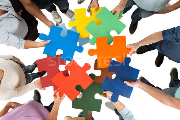 Creative Business People Holding Colorful Puzzle Pieces Stock photo © AndreyPopov