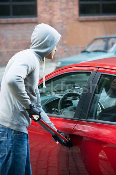 Thief Using Crowbar To Open Car's Door Stock photo © AndreyPopov