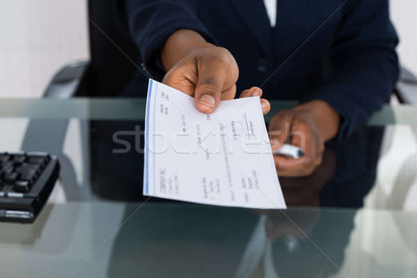 Person's Hand Giving Cheque Stock photo © AndreyPopov