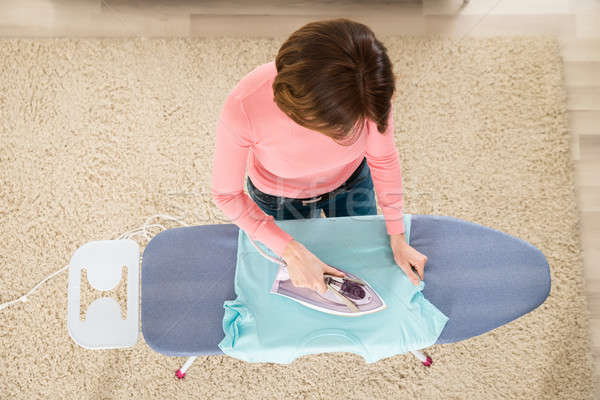 Woman Ironing Clothes With Steam Iron Stock photo © AndreyPopov