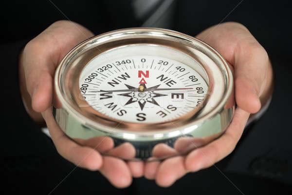 Businessman Hand Holding Compass Stock photo © AndreyPopov
