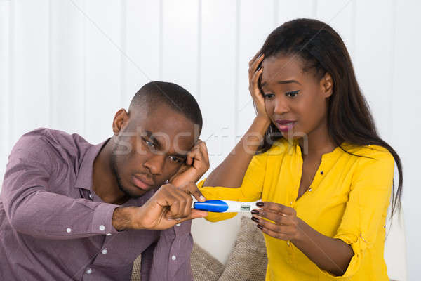 Couple Looking At Pregnancy Test Stock photo © AndreyPopov