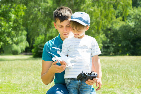 Father And Son Playing With The Drone Stock photo © AndreyPopov