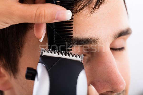 Primer plano peluquero pelo peluquería cara Foto stock © AndreyPopov