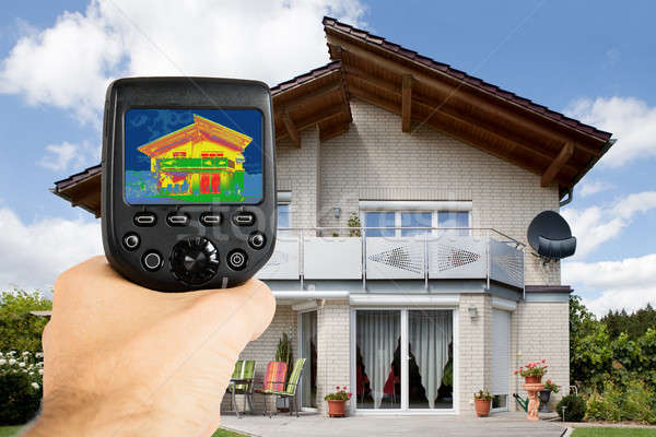 Person Using Infrared Thermal Camera Outside The House Stock photo © AndreyPopov