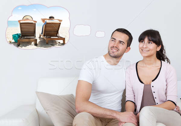 Couple Dreaming Of Spending Vacation On Beach Stock photo © AndreyPopov