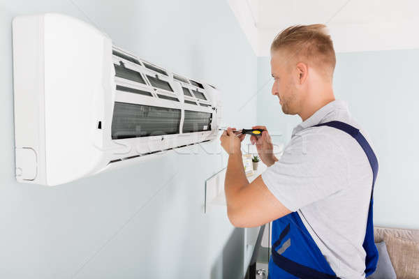 Technician Fixing Air Conditioner Stock photo © AndreyPopov