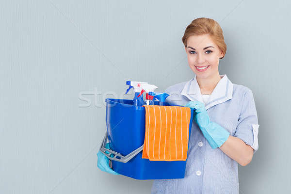 Female Janitor Holding Cleaning Equipment Stock photo © AndreyPopov