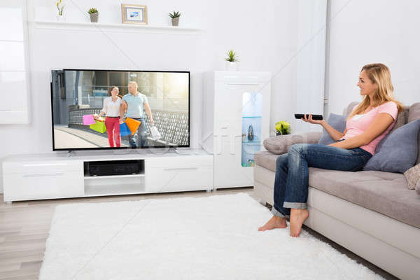 Woman Watching Television At Home Stock photo © AndreyPopov