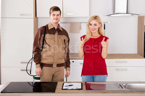 Portrait Of Woman And Pest Control Worker In Kitchen Stock photo © AndreyPopov