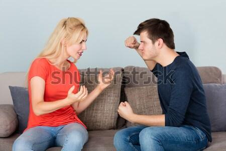 Casal sessão sofá outro jovem frustrado Foto stock © AndreyPopov