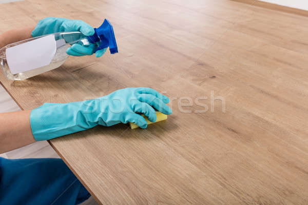 Person Wearing Glove Cleaning Kitchen Worktop Stock photo © AndreyPopov