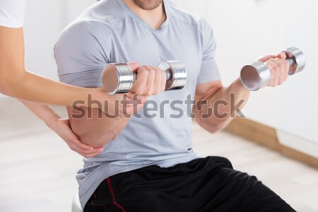 Instructor Helping Man To Exercise Stock photo © AndreyPopov