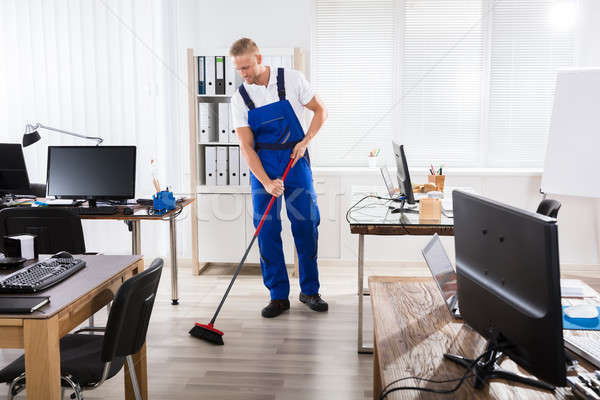 Male Janitor Cleaning Floor With Broom Stock photo © AndreyPopov