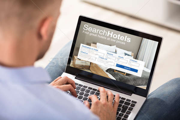 Person Searching Hotels On Laptop Stock photo © AndreyPopov