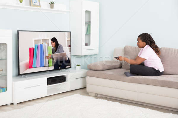 Girl Watching Television Stock photo © AndreyPopov