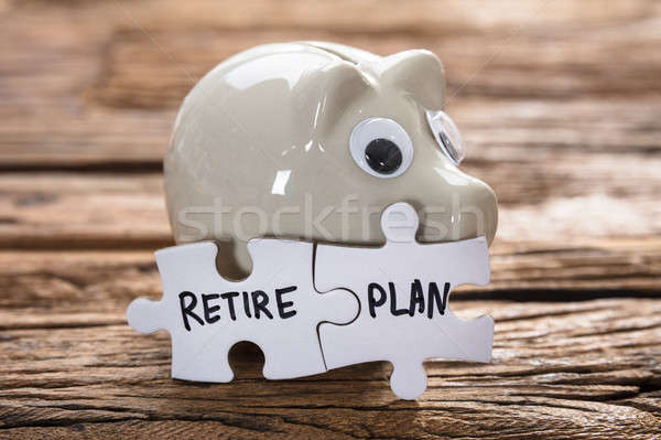 Connected Retire Plan Jigsaw Pieces By Piggybank Stock photo © AndreyPopov