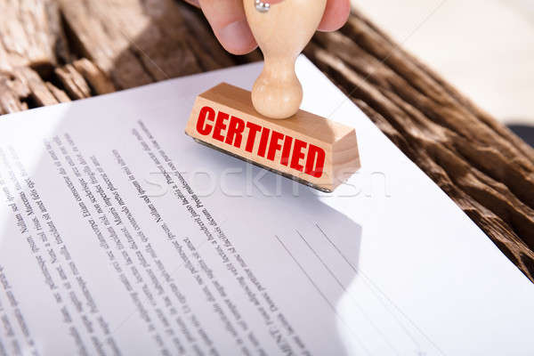 Person Holding Certified Stamp On Document Stock photo © AndreyPopov