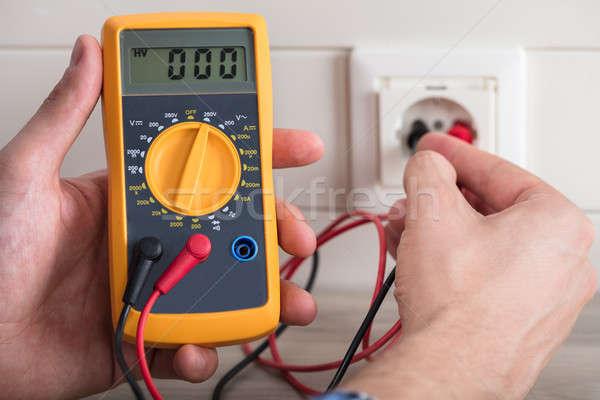 Metering Socket Voltage With Digital Multimeter Stock photo © AndreyPopov