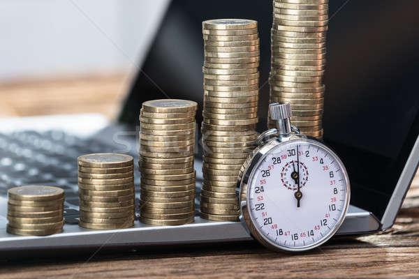 Chronomètre pièces portable bureau Photo stock © AndreyPopov