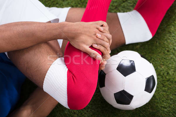 Injured Soccer Player On Field Stock photo © AndreyPopov