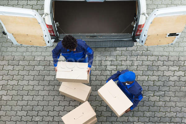 Delivery Men Unloading The Cardboard Boxes Stock photo © AndreyPopov