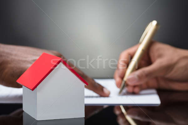 Person Signing A Mortgage Document Stock photo © AndreyPopov