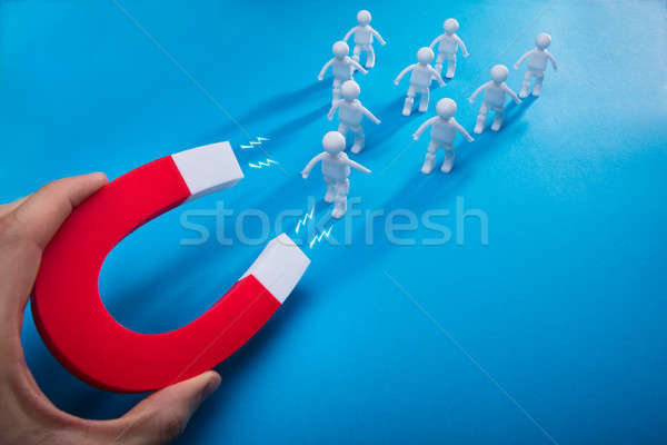 Személy húz emberi patkó mágnes közelkép Stock fotó © AndreyPopov
