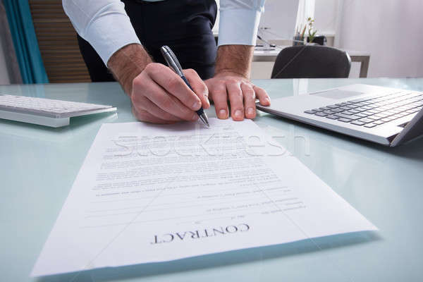 Businessperson Signing Contract Form Stock photo © AndreyPopov