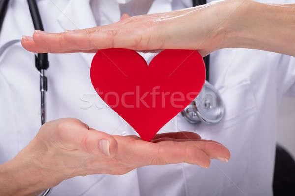 Doctor Protecting Heart Shape Stock photo © AndreyPopov