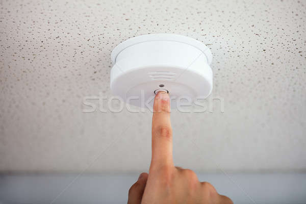 Person Testing Smoke Detector Stock photo © AndreyPopov