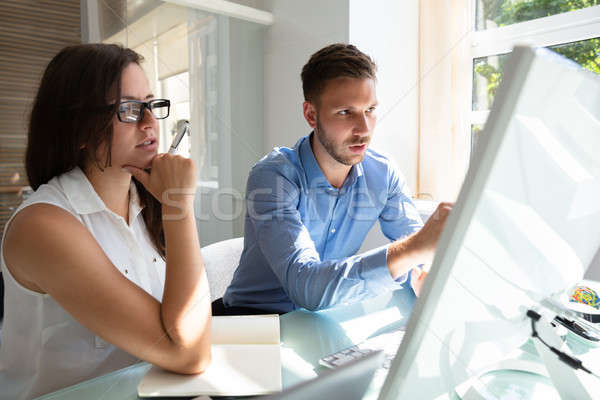 Deux gens d'affaires regarder ordinateur conversation professionnels Photo stock © AndreyPopov