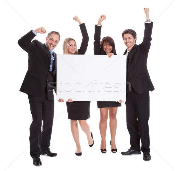 Stock fotó: Csoport · boldog · üzlet · kollégák · tart · óriásplakát