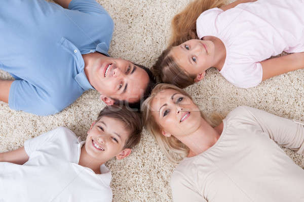 Close-up Of Happy Family Looking Up Together Stock photo © AndreyPopov
