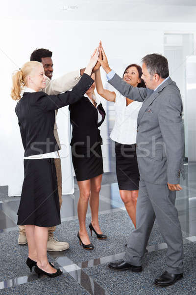 Business People Celebrating With A High-five Stock photo © AndreyPopov