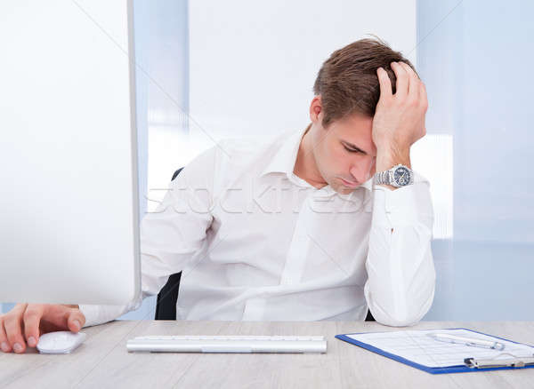 Young Tired Businessman Sitting In Office Stock photo © AndreyPopov