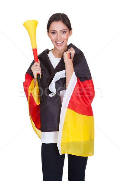 Happy Female German Supporter With Vuvuzela Stock photo © AndreyPopov