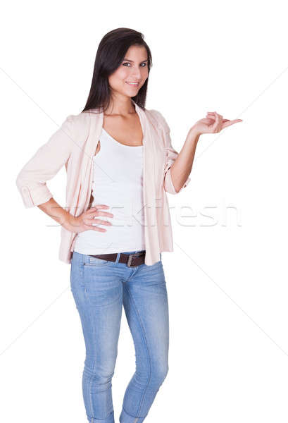Beautiful trendy woman with an empty palm Stock photo © AndreyPopov