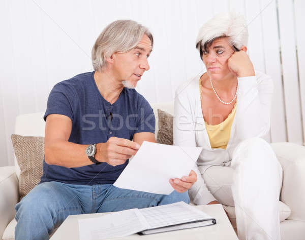 Senior couple discussing a document Stock photo © AndreyPopov