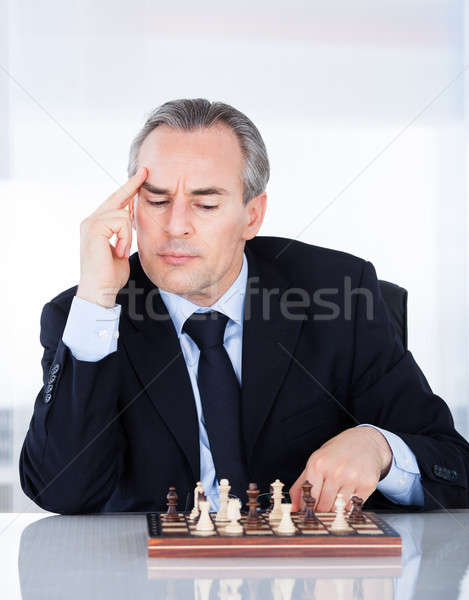 Maduro empresário jogar xadrez retrato negócio Foto stock © AndreyPopov