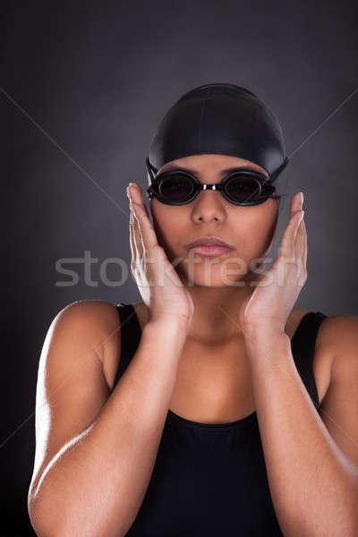 Portret jonge vrouwelijke zwemmer geïsoleerd zwarte Stockfoto © AndreyPopov