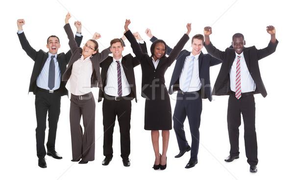 Sikeres üzletemberek karok a magasban teljes alakos portré áll Stock fotó © AndreyPopov