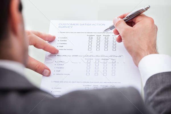 бизнесмен заполнение клиентов обзор форме Сток-фото © AndreyPopov