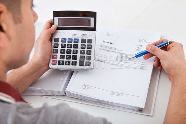 Man Calculating Financial Expenses At Home Stock photo © AndreyPopov