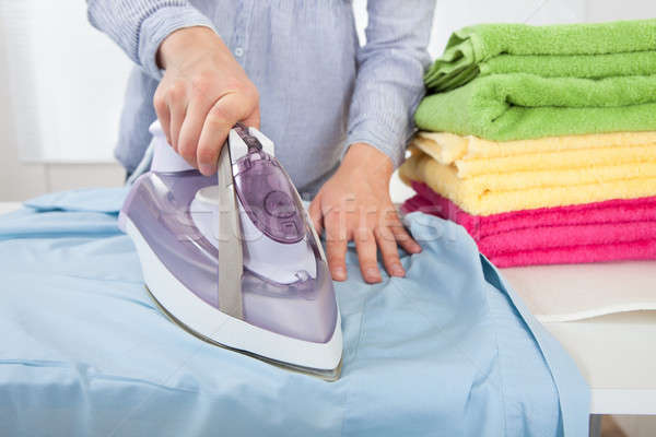 Midsection Of Woman Ironing Shirt Stock photo © AndreyPopov